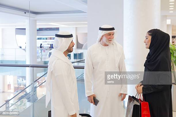 Arab people meeting at shopping mall
