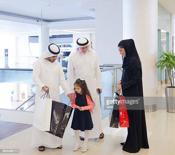 Arab people meeting at shopping mall