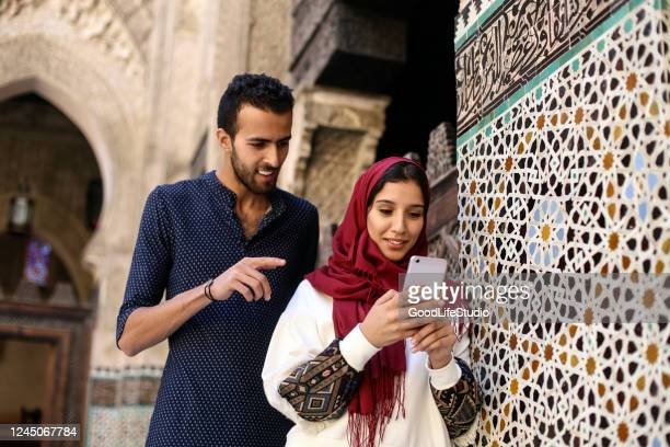 arab people using an app - north africa stock pictures, royalty-free photos & images