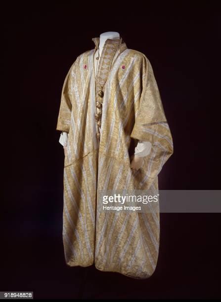 Arab robe worn by TE Lawrence 1916 Dimensions height x width width at hem 1335 x 1435 cmlength tassle 375 cm