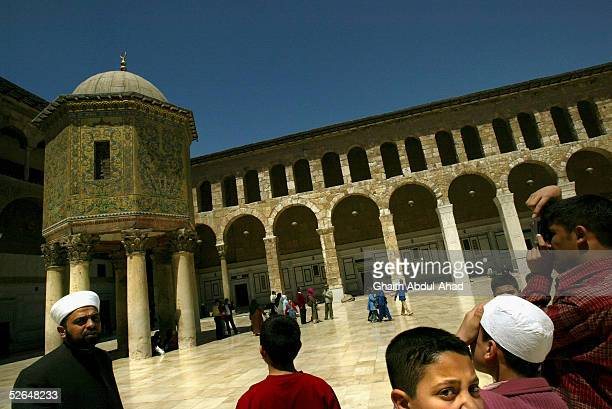 Arab School children take pictures inside the 8th century Umayyad Mosque in Damascus on April 17 2005 in Damascus Syria Despite American threats and...