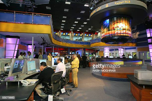 Arab staff work at alJazeera's new stateoftheart newsroom late 15 June 2005 The Dohabased satellite news channel which has moved into a new...