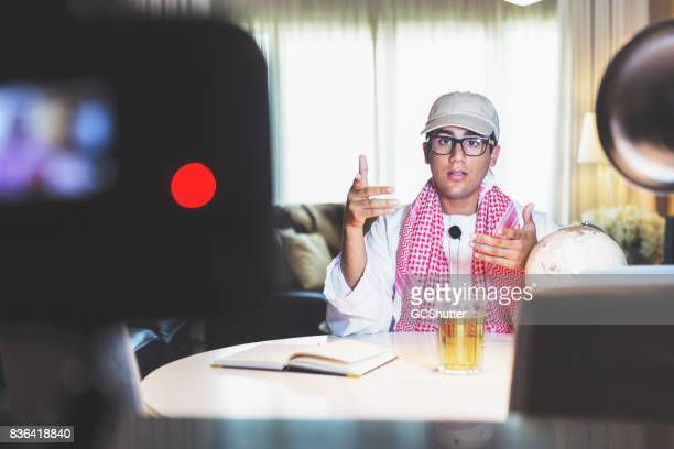 Arab video blogger greeting his audience to another live video broadcast