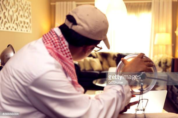 arab vlogger checking his light set up for his makeshift studio - sound recording equipment stock pictures, royalty-free photos & images