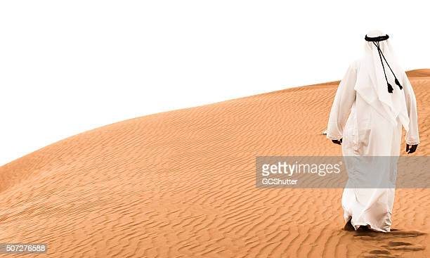 arab walking on the dunes - ceremonial robe stock pictures, royalty-free photos & images