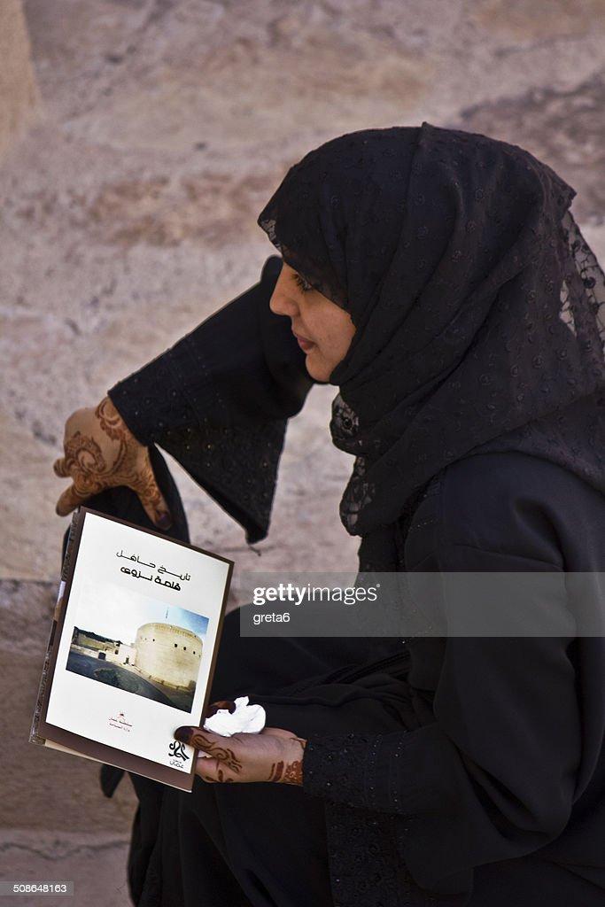 Arab woman at Nizwa Castle : Stock Photo