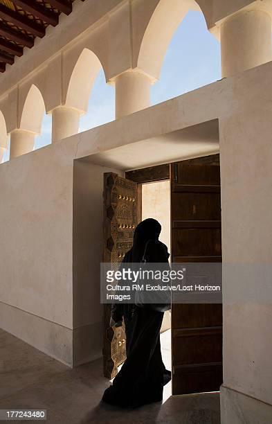 Arab woman exiting a Mosque, Doha, Qatar