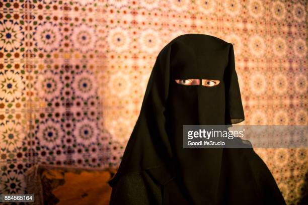 arab woman in traditional burqa - veil stock photos and pictures