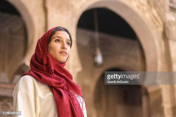 arab woman - religious veil stock pictures, royalty-free photos & images
