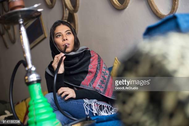 arab woman smoking hookah - hookah stock photos and pictures