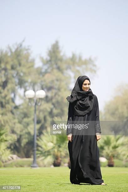 Arab woman standing on green grasses