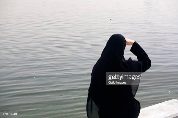 Arab Woman Staring Out into the Sea. Dubai, United Arab Emirates