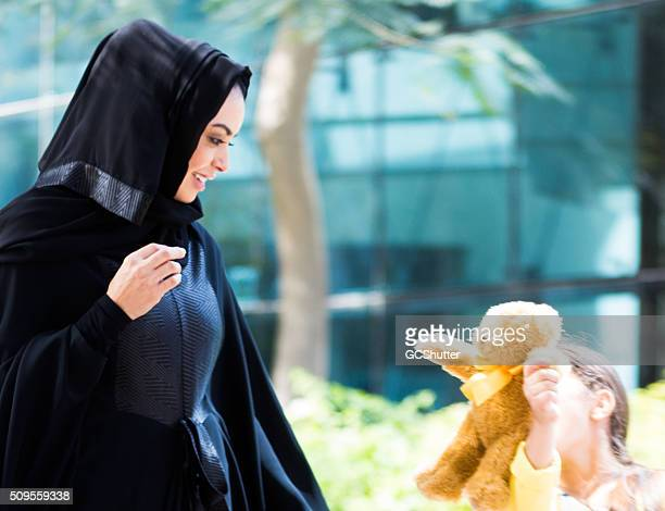 Arab woman with her daughter in a park