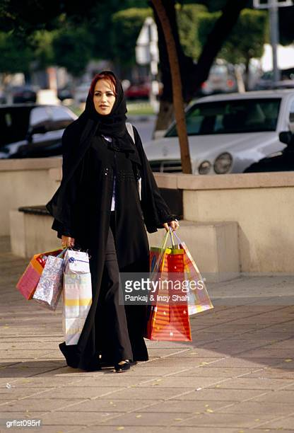 Arab Woman with shopping bags