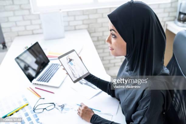 Arab woman working in fashion studio