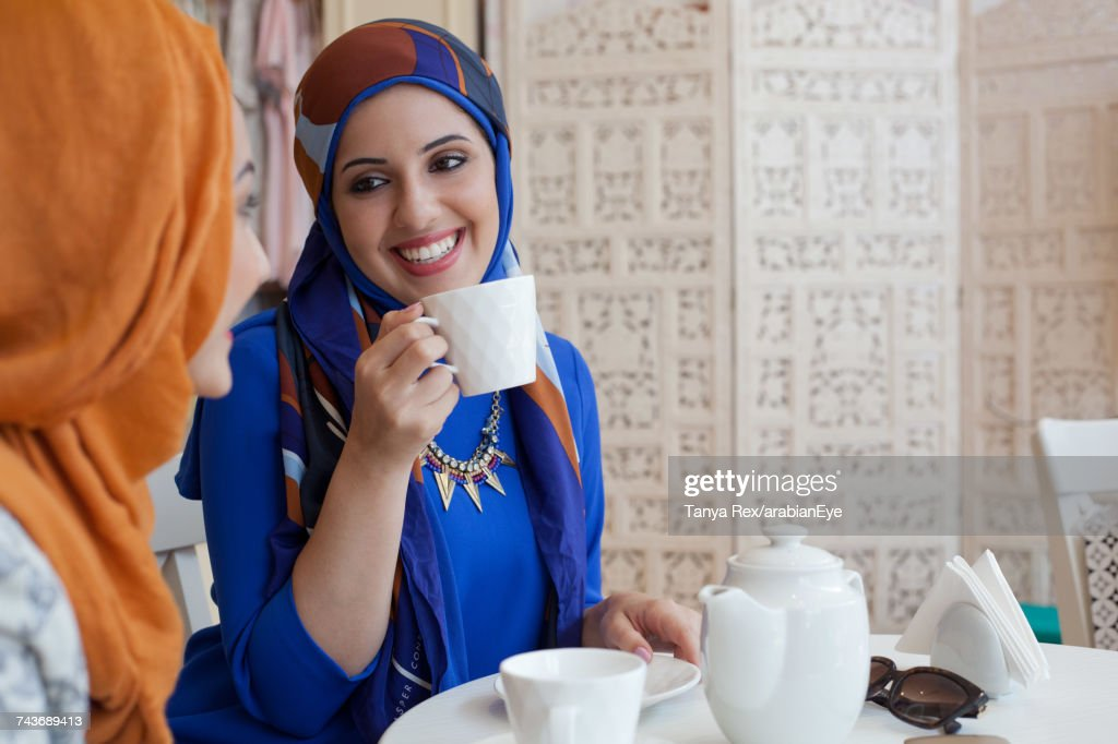Arab women chatting at café.  : Stock Photo