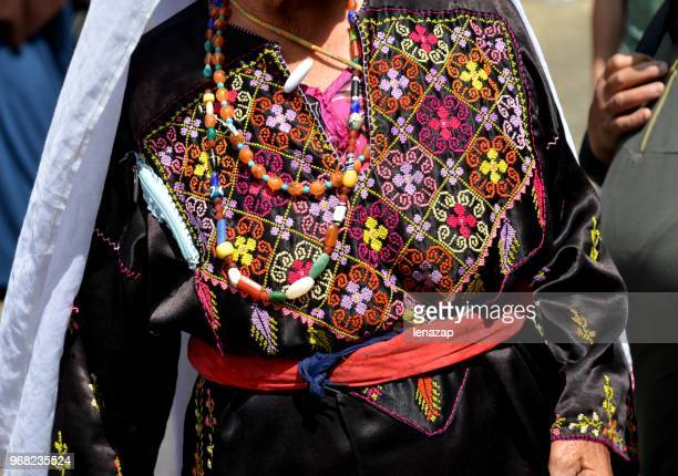 arab women in traditional clothes with embroidery. - palestinian stock pictures, royalty-free photos & images