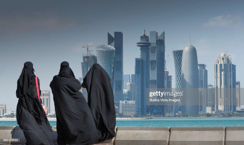 Arab women watching futuristic city : Stock Photo