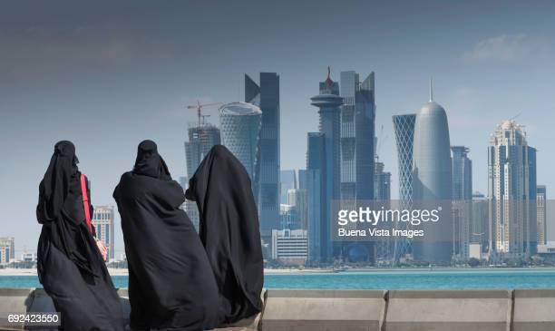 Arab women watching futuristic city
