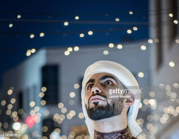 arab young man on night street - ramadan stock pictures, royalty-free photos & images
