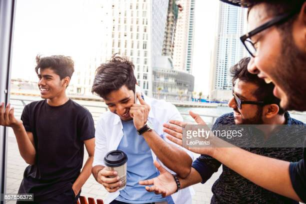arab youth - group of middle eastern male friends hanging out in dubai - gulf countries stock pictures, royalty-free photos & images