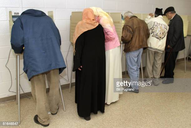 Arab-Americans vote at Salina School November 2, 2004 in Dearborn, Michigan. Polls are showing a tight race between the incumbent president Bush and...