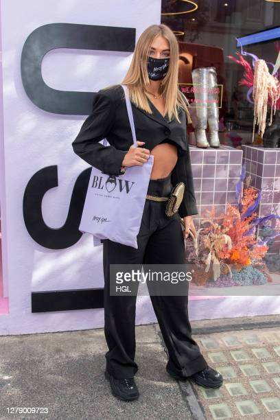 Arabella Chi leaving the Nasty Gal FT. Emrata collection launch at Busi Cafe on October 07, 2020 in London, England.