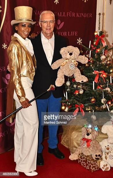 Arabella Kiesbauer and Franz Beckenbauer pose for a photograph during the Energy For Life christmas ball for children at Hofburg Vienna on December...