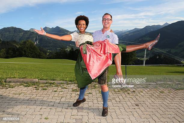 Arabella Kiesbauer and her husband Florens Eblinger during the 12th Almrauschparty at Rosi's Sonnbergstuben on July 31 2015 in Kitzbuehel Austria