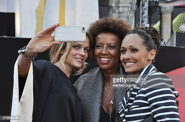 Arabella Kiesbauer Mirjam Weichselbraun and Alice Tumler pose during the Eurovision Song Contest 2015 Opening Ceremony at Rathaus Wien ahead of the...