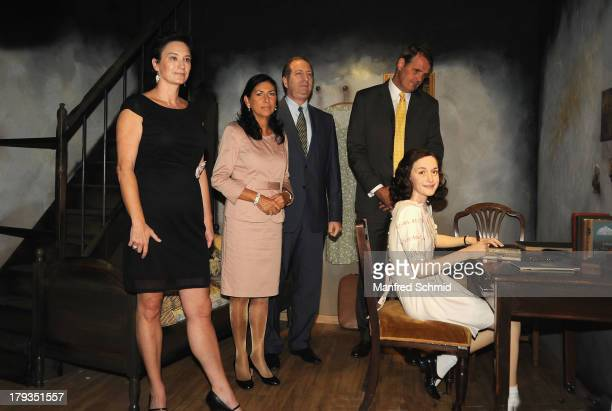 Arabella Kruschinski Danielle Spera Aviv ShirOn and Roelof Buffinga pose for a photograph during the unveiling of new waxwork Anne Frank at Madame...