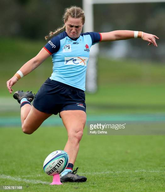 Arabella McKenzie of the Waratahs kicks a conversion during the Super W Final match between the NSW Waratahs and the Queensland Reds at Coffs Harbour...