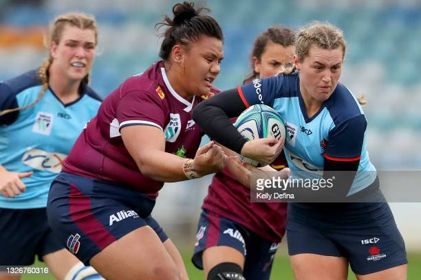 Arabella McKenzie of the Waratahs runs with the ball during the Super W Final match between the NSW Waratahs and the Queensland Reds at Coffs Harbour...