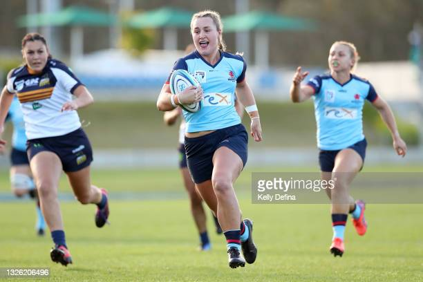 Arabella McKenzie of the Waratahs scores a try during the round three Super W match between the NSW Waratahs and the ACT Brumbies at Coffs Harbour...