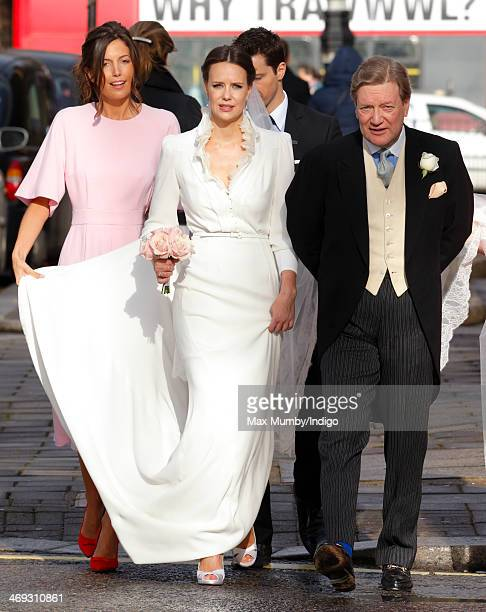 Arabella Musgrave accompanied by her father Nicholas Musgrave arrives at St Paul's Church Knightsbridge for her wedding to George GalliersPratt on...