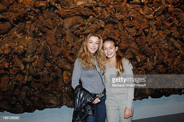Arabelle ReilleMahdavi and her daughter Jade Mahdavi pose in front Who's afraid of the big bad wolf of Adel Abdessemed during Adel Abdessemed...