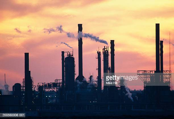 arabia, bahrain, oil refinery at sunset - bahrain stock pictures, royalty-free photos & images
