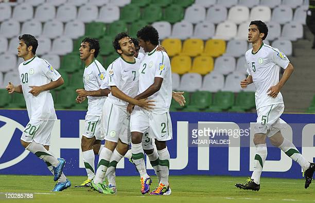 Arabia Saudita Yahya Dagriri celebrates with teammates after scoring against Guatemala during their FIFA World Cup U20 Group D football match at the...