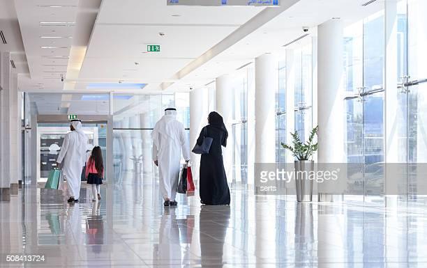 Arabian family at shopping mall