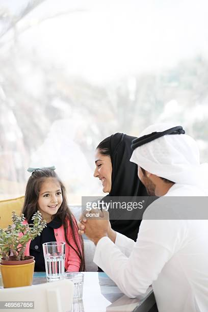 Arabian family enjoying leisure time in a cafe