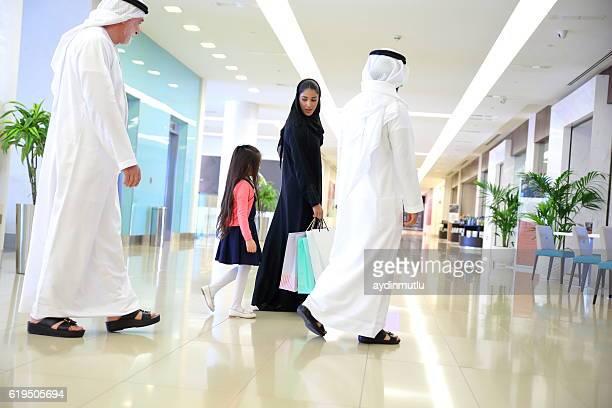 Arabian family in shopping mall
