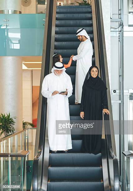 Arabian family on a shopping mall's escalator.