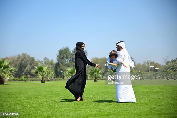 Arabian family playing in the park