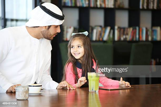 arabian father caring his daughter - bahrain stock pictures, royalty-free photos & images
