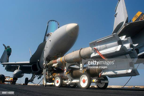 Arabian Gulf, August 13, 2004 - A weapons skid carrying 500-pound (GBU-12) laser guided bombs is staged on the ship's flight deck aboard USS John F. Kennedy (CV-67).  The weapons were prepared for an F/A-18 Hornet.