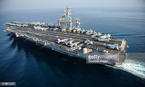 arabian gulf, august 13, 2013 - the aircraft carrier uss nimitz (cvn-68) is underway in the arabian gulf. - aircraft carrier stock pictures, royalty-free photos & images
