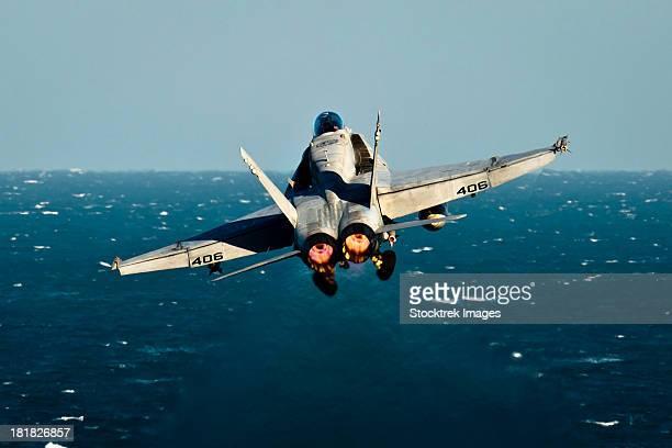 Arabian Gulf, December 3, 2011 - An F/A-18C Hornet launches from the Nimitz-class aircraft carrier USS John C. Stennis.