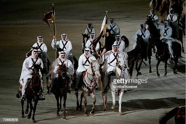 Arabian horses and desert horsemen enter the arena during the Opening Ceremony of the 15th Asian Games Doha 2006 at the Khalifa stadium on December 1...