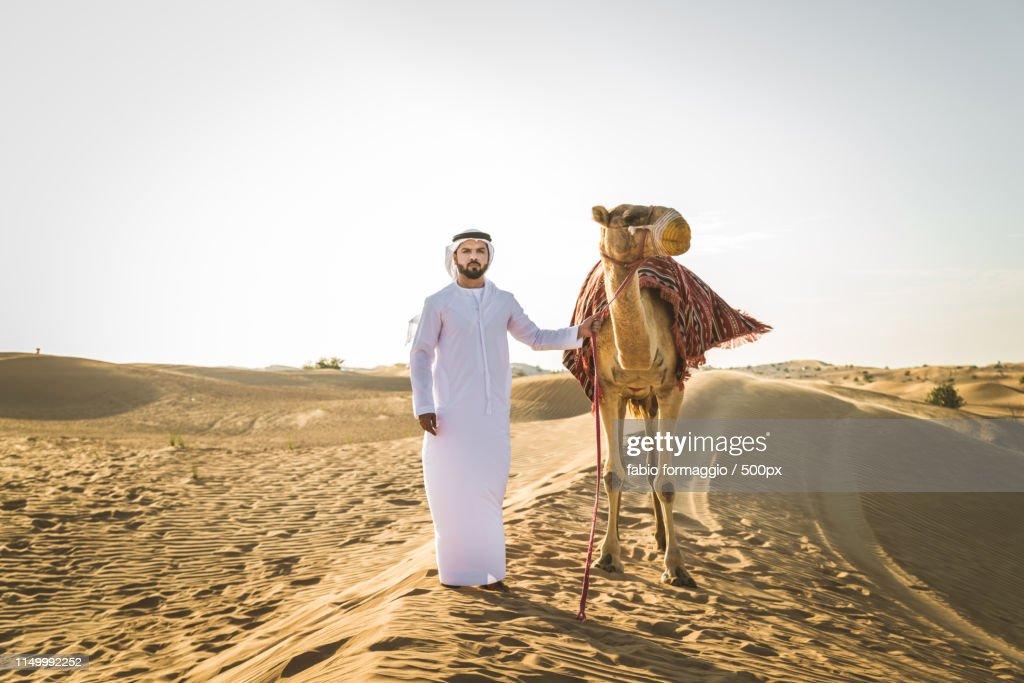 Arabian Man With Camel In The Desert : Stock Photo