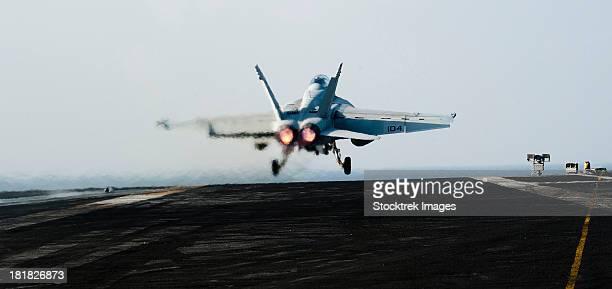 Arabian Sea, January 15, 2012 - An F/A-18F Super Hornet launches off the flight deck of the Nimitz-class aircraft carrier USS John C. Stennis.